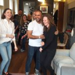 Friends laugh together during a Playful workshop for adults