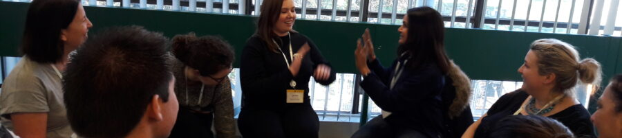 Staff hand clapping during a wellbeing at work event