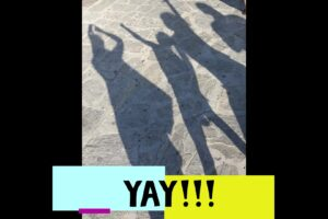 Shadows of poeple celebrating and the word Yay!!