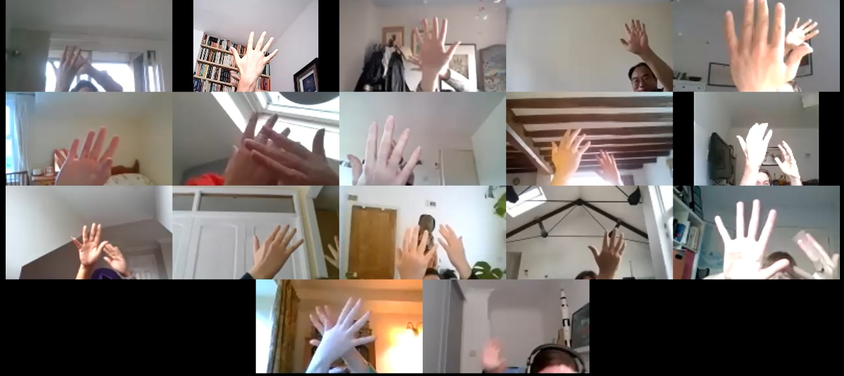 A picture of hands on a zoom team building online session