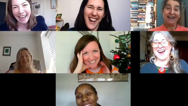 A group of women laughing during a Zoom session