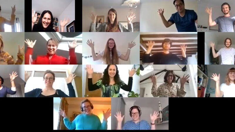 Zoom screen with people showing jazz hands
